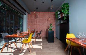 Cucina dinamica e moderna nel nuovo ristorante Moi nel quartiere Fleming di Roma